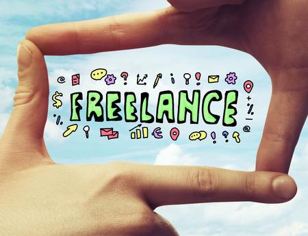 freelancers: Creative sketch framed with fingers on sky background. Freelance concept