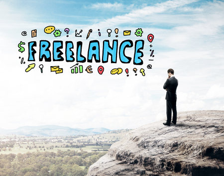 freelancers: Thoughtful young man on mountain top with creative drawing. Freelance concept