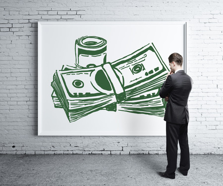 creative money: Thoughtful young man looking at whiteboard with creative money sketch in brick room. Money concept. 3D Rendering