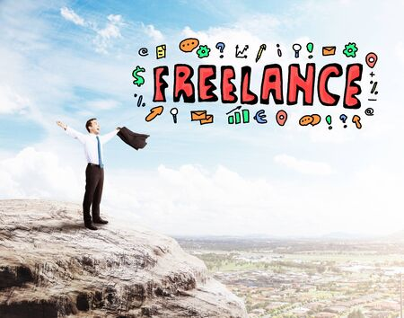 freelancers: Young businessman celebrating success on mountain top with creative colorful sketch. Freelance concept Stock Photo