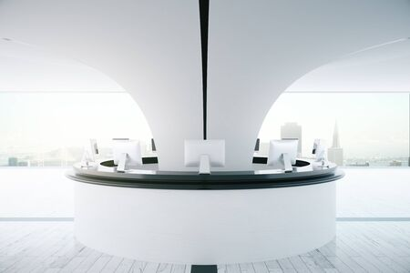 reception desk: Circular white reception desk with computer monitors in interior with city view and daylight. 3D Rendering Stock Photo