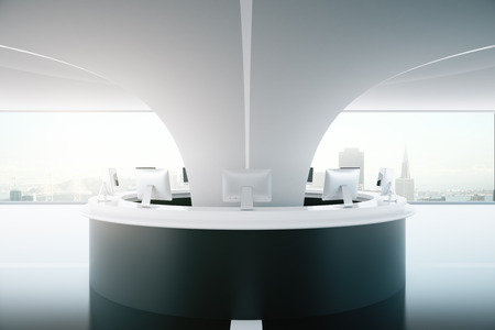 daylight: Circular black reception desk with computer monitors in interior with city view and daylight. 3D Rendering Stock Photo