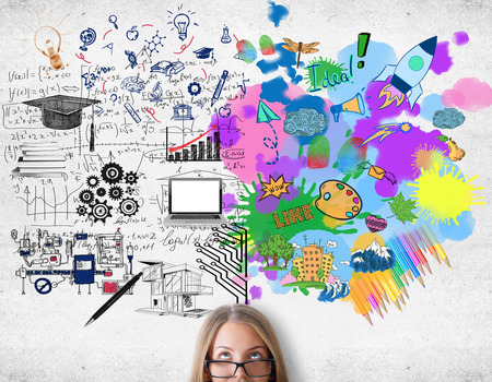 Creative and analytical thinking concept. Attractive woman with colorful sketch on concrete background Archivio Fotografico