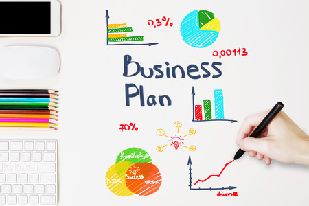 business plan: Hand drawing business plan on white desktop with objects