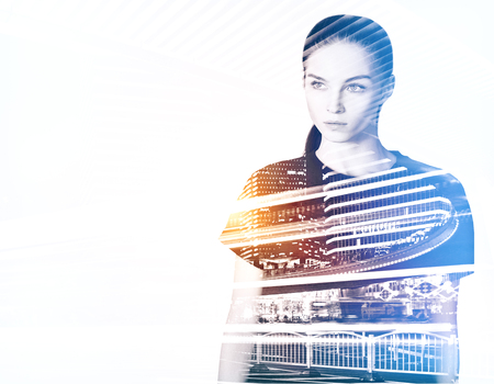 multiple exposure: Portrait of attractive young woman on city background. Tomorrow concept. Double exposure Stock Photo