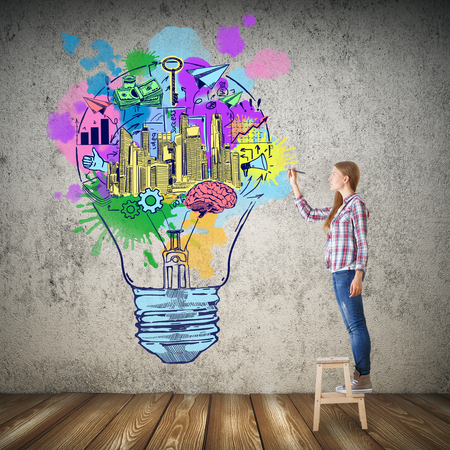 finacial: Girl drawing colorful lamp in concrete room with wooden floor. Creative idea concept Stock Photo