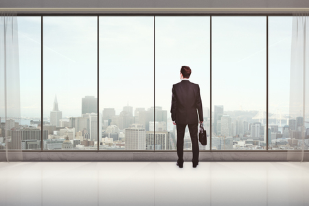 man looking out: Back view of male with briefcase in modern interior with city view, looking into the distance. Research concept. 3D Rendering