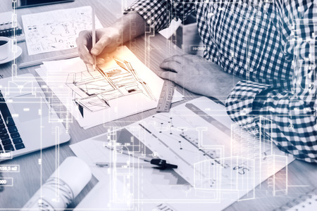 engineering and technology: Young architect drawing construction sketch at workplace. Engineering concept Stock Photo