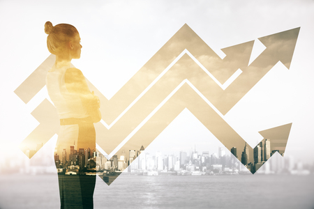 Attractive female on abstract city background with business chart arrows. Double exposure. Success concept