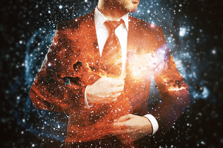 Confident man in suit on abstract space background. Double exposure. Stock Photo