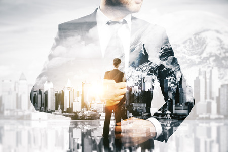 man looking: Thoughtful businesspeople on abstract city and space background. Research concept. Double exposure. Stock Photo