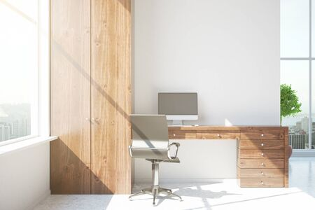 loft interior: Modern concrete interior with wooden workplace and sunlight. 3D Rendering Stock Photo