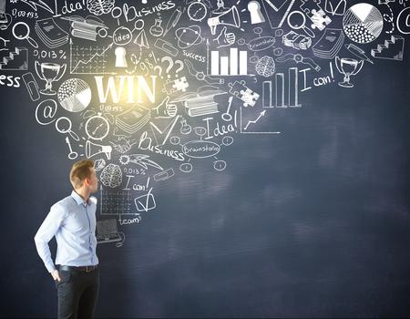 businessman thinking: businessman thinking and drawing financial sketch on blackboard