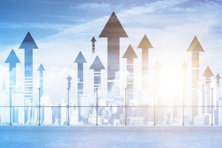 Rooftop with upward arrows on city background. Double exposure. Success concept Standard-Bild