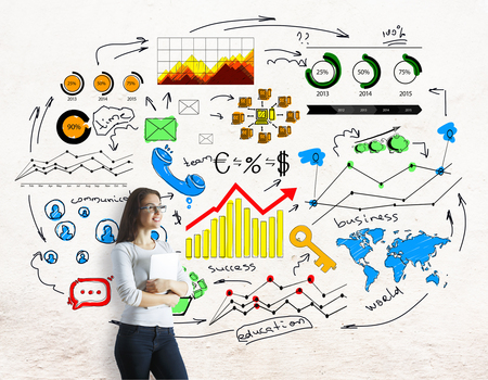 finance concept: Businesswoman with laptop standing on concrete background with colorful business sketch. Finance concept
