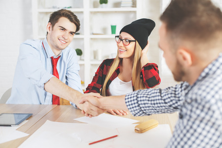 interviewed: Handsome young guy accepted for a job position after interview. Success concept Stock Photo