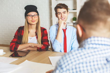 interviewed: Attractive young male and female being interviewed for a job. Teamwork concept Stock Photo