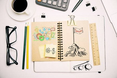 business supplies: Top view of workplace with business sketch, supplies and coffee cup. Success concept Stock Photo