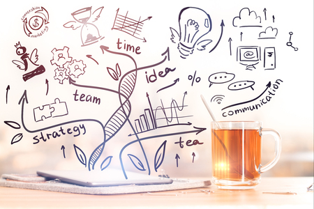 table top: Close up of workplace with tea cup, paperwork and creative business sketch. Success concept