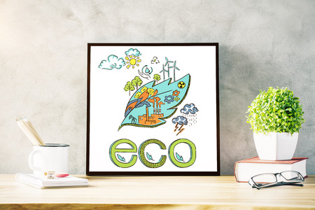 ecology background: Front view of creative workplace with plants, supplies and eco sketch. Concrete wall background. Ecology concept