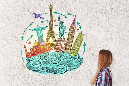 textured wall: Young woman with travel sketch on textured concrete wall background. Traveling concept