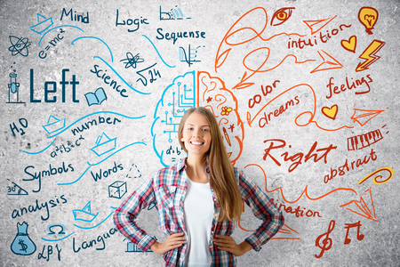 Cheerful young girl on concrete background with brain sketch. Creative and analytical thinking concept