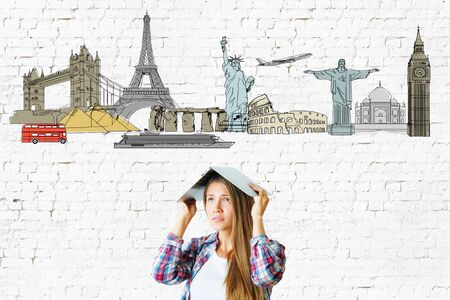 textured wall: Young woman with travel sketch on textured brick wall background. Tourism concept Stock Photo