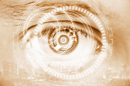 Close up of cyber eye on city background. Double exposure. Future technologies concept