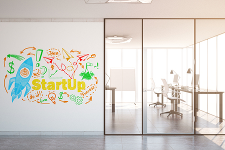 modern office interior: Modern office interior with colorful rocket ship sketch on concrete wall. Startup concept. Toned image. 3D Rendering