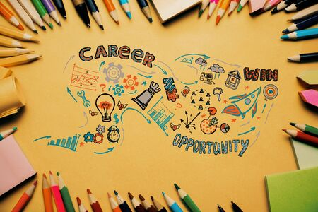 idea sketch: Top view of orange desktop with colorful supplies and creative business sketch. Idea concept Stock Photo