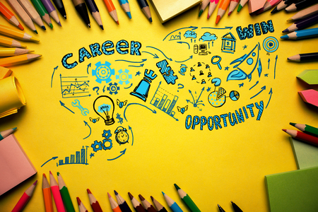 view: Top view of yellow desktop with colorful supplies and creative business sketch. Career concept