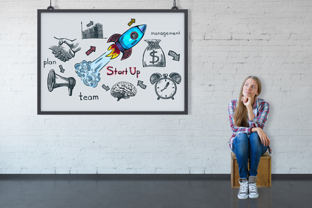 communication: Thoughtful young caucasian girl sitting in brick interior with rocket sketch in frame. Start up concept. 3D Rendering