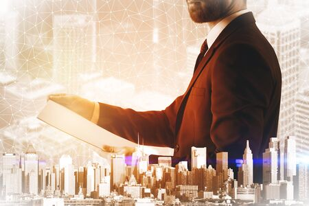 european: Side view of handsome man with paperwork on abstract city background with polygonal pattern. Double exposure