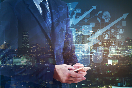 on the handphone: Businessman using smartphone with abstract business pattern on night city background. Trading concept. Double exposure