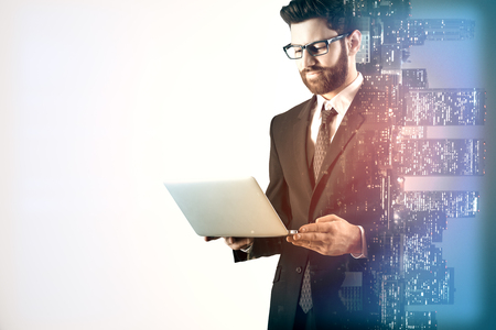 Businessman using laptop on city background with copy space. Communication concept. Double exposure Stock Photo