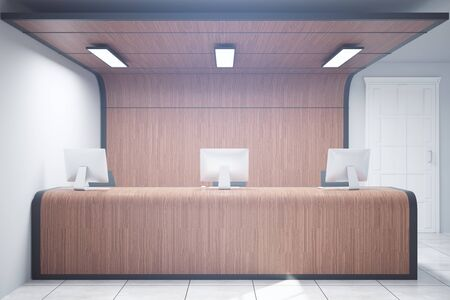 business meeting: Front view of modern wooden reception counter in interior. 3D Rendering Stock Photo