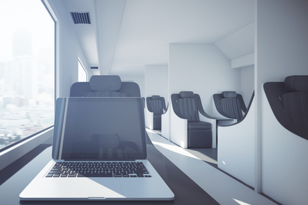 computer education: Close up of blank laptop placed on modern train table. Travel concept. Mock up, 3D Rendering