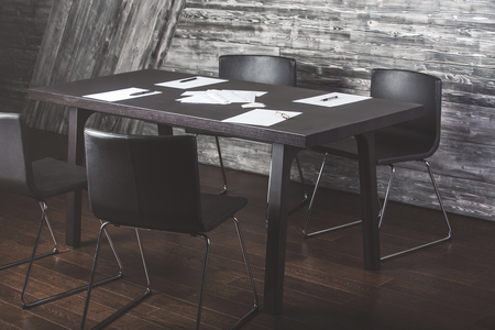 wood floor: Interior with white paper sheets and pens on dark wooden desktop