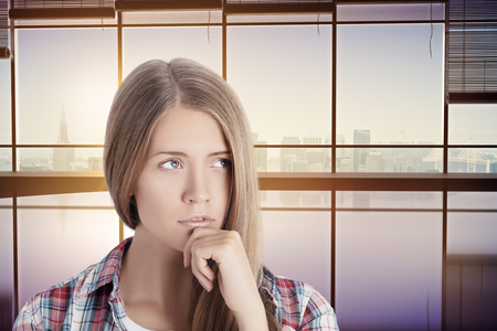 woman looking up: Portrait of thoughtful young woman in interior with city view. 3D Rendering Stock Photo