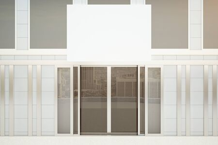 forepart: Front view of concrete tile building exterior with glass doors and empty billboard. Ad concept. Mock up, 3D Rendering Stock Photo