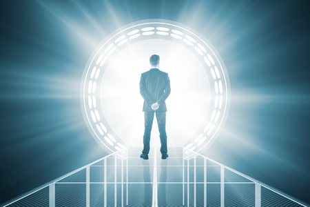 Back view of businessman standing in front of abstract blue teleport with bright light. 3D Rendering