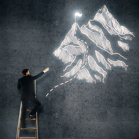 winner man: Back view of young man on ladder drawing mountains with flag on white background. Winner concept