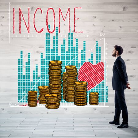 Thoughtful young businessman in wooden interior with income sketch. Profit concept Stock Photo
