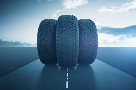 Front view of three tires in the middle of road. Bright sky background. Transportation concept. Toned image. 3D Rendering