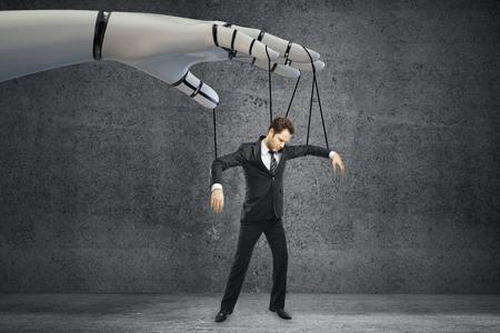 Roboter Hand Manipulation Geschäftsmann auf konkreten Hintergrund. Zukunftskonzept