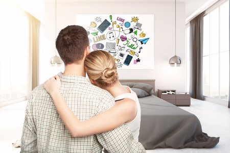 looking at view: Back view of young couple looking at poster with social media sketch in modern bedroom interior. 3D Rendering