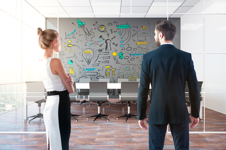 drawing room: Back view of young businessman and woman looking at business sketch in modern conference room with city view. Teamwork concept. 3D Rendering Stock Photo