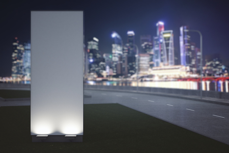 communication: Close up of empty vertical ad stand on night city background. Advertisement concept. 3D Rendering
