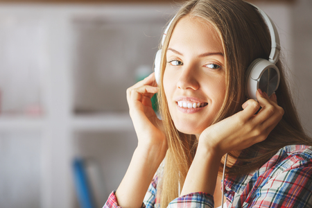 music background: Portrait of smiling european woman with headphones. Music concept Stock Photo