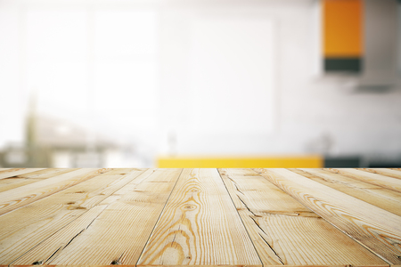 Close up of light wooden table. Blurry interior in the background. Mock up, 3D Rendering Stock Photo
